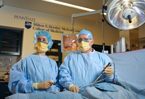 Two physicians perfom minimally invasive surgery in a Penn State Hershey operating room.